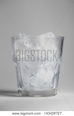 Large Glass With Ice On A Gray Background
