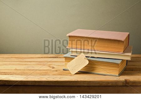 Old books with price tag on wooden table