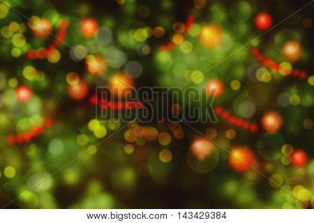 Christmas holiday bokeh background with tree and decorations