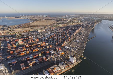 Los Angeles, California, USA - August 17, 2016:  Afternoon aerial view of Port of Los Angeles berths, cranes and containers.