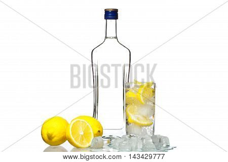 Bottle Of Vodka And Wine Glass With Lemon And Ice Isolated On Wh