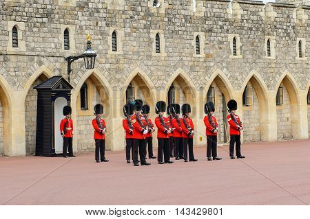WINDSOR, GREAT BRITAIN - JULY 21, 2016: Change of guard at the Windsor Castle, Berkshire, England. Official Residence of Her Majesty The Queen