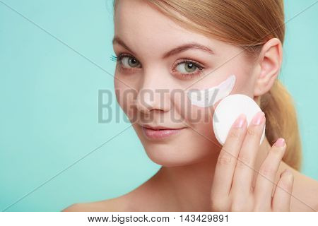 Woman Removing Makeup With Cream And Cotton Pad