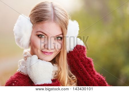 Portrait Of Pretty Smiling Woman In White Earmuffs.