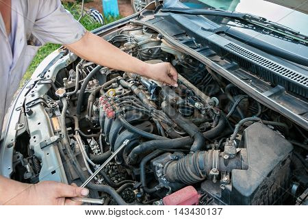 auto mechanic repairing a old cars .