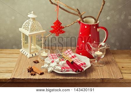 Christmas table setting with christmas decorations and candles