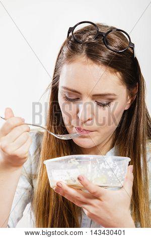 Woman eating fresh vegetable salad. Happy and joyful girl enjoying healthy food. Nutrition.