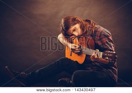 Hippie With Wooden Guitar.