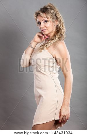 Beauty fashion people concept. Lady with beige dress. Beautiful woman with nice outfit.