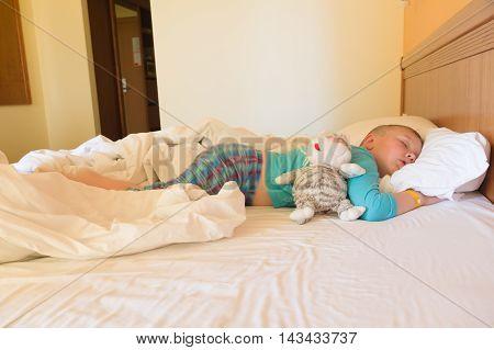 Boy Sleeping In A Hotel