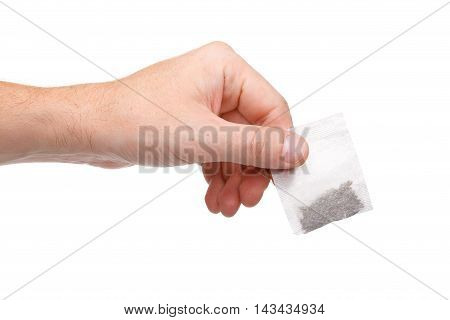 Hand Holding Teabag Isolated On White Background