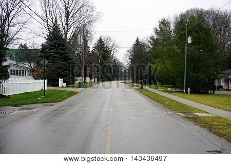 WEQUETONSING, MICHIGAN / UNITED STATES - DECEMBER 23, 2015: A view of Pennsylvania Avenue in Wequetonsing, Michigan during December.