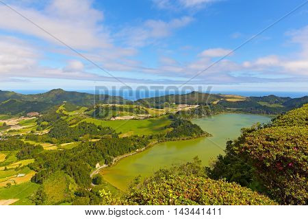 Panoramic view of Lagoa das Furnas a lake in volcanic crater near Furnas in Azores Portugal. Scenic view of agricultural area of Sao Miguel island.