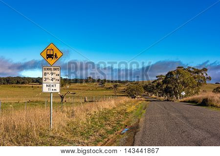 Australian outback road with school bus stop sign. Unmarked rural path. Myrtleville NSW Australia