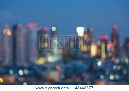 Twilights urban building lights night view, abstract blurred bokeh background