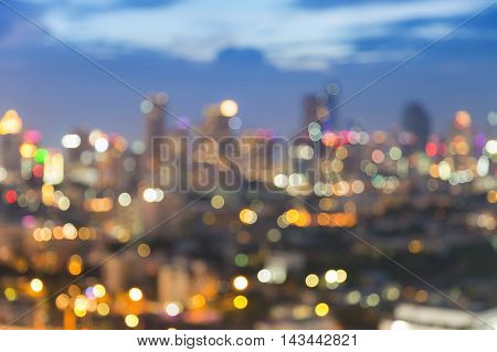 Twilights blurred bokeh urban lights, abstract background