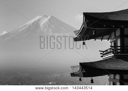 Black and White, Mt. Fuji viewed from behind red Chureito Pagoda, Japan during late winter