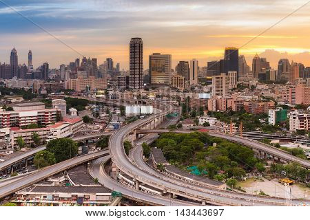 Cityscape and highway interchanged with sunset sky background