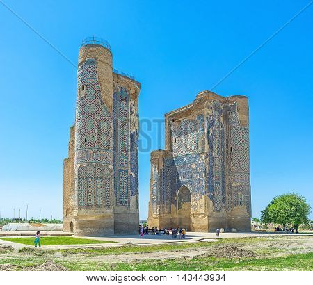 SHAKHRISABZ UZBEKISTAN - MAY 2 2015: The Ak-Saray was planned as the Summer Palace of Tamerlane nowadays the ruined portal is the only preserved part of it on May 2 in Shakhrisabz.