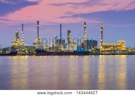 Dramatic sky during sunrise, Petrol chemical refinery industry plant waterfront