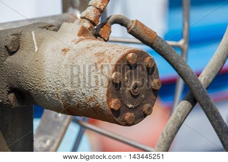 Closeup of a rusted iron component on a boat in a fishing harbor in Larnaca