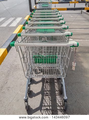 Shopping Carts in a row on a parking near supermarket