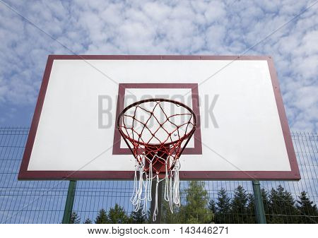 Basketball board on the sports field against the sky