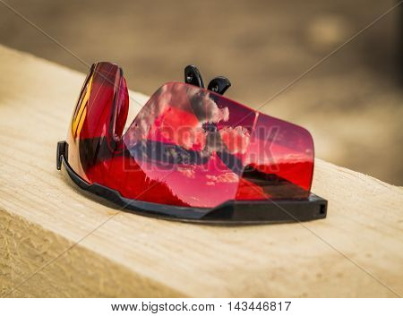 Red industrial goggles with the laser level close-up
