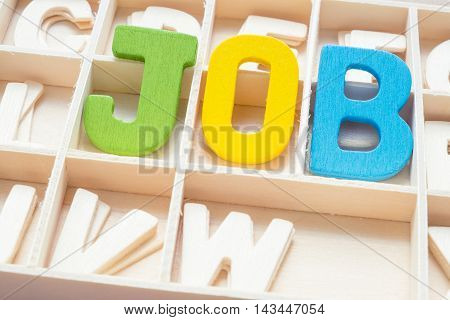 Colorful Job wording - text uppercase letter made from wood in the box with other letters - concept of job hunting