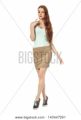 Young Girl In Skirt Posing Isolated On White