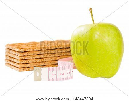 Measuring tape, crispbread and delicious green apple isolated on white. Diet or healthy eating concept.