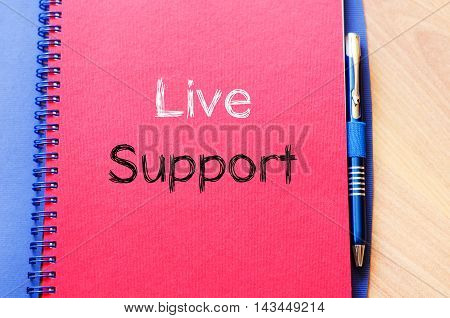Live support text concept write on notebook