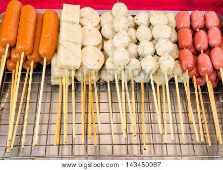 Sausages, meatballs and skewers snack in street food