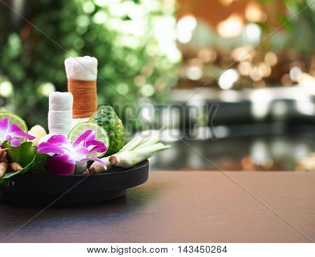 Natural Spa Ingredients herbal compress ball and herbal Ingredients for alternative medicine and relaxation Thai Spa theme with silk fabric, Thailand, select focus