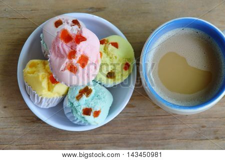 colorful cotton wool cake on cup and coffee
