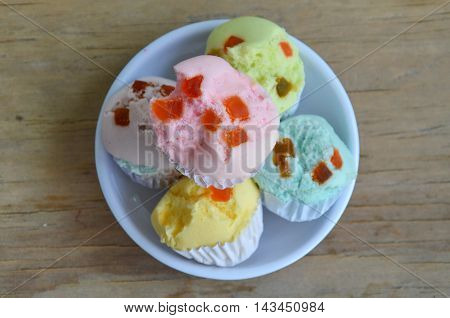 colorful cotton wool cake topping dried fruit on cup