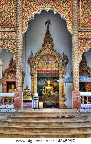 Buddha statue in a Thai temple building