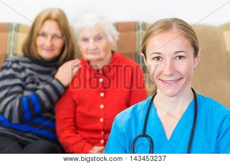 Elderly woman and her daughter at the doctor