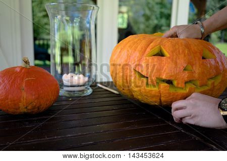 Woman tearing big pumpkins for Halloween. preparation for the holiday