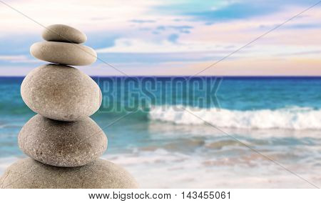 Stone stack or stack rock of pebbles at the beach with copy space. Balanced stones.