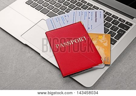 Credit card and tickets on laptop keyboard