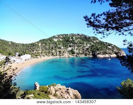 Beach Cala San Vicent on ibiza Island, turquoise water and blue sky.