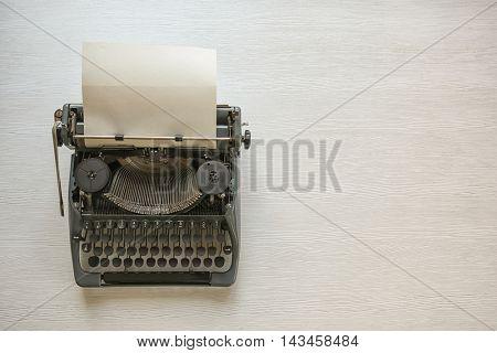 Vintage typewriter on a wooden background