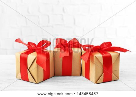 Gift boxes on brick wall background