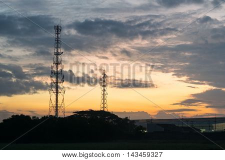 Two Telecommunications tower in the evening at Thailand