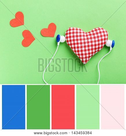 Headphones and heart on green paper background with color palette