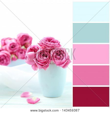Beautiful Pink Roses On A White Wooden Table With Color Palette