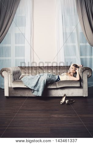 Beautiful Woman with light hair Relaxing on Luxury Interior