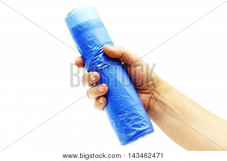 Female hand with a garbage bags roll