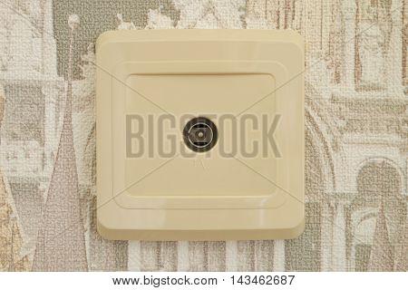 TV antenna socket on the wall close-up